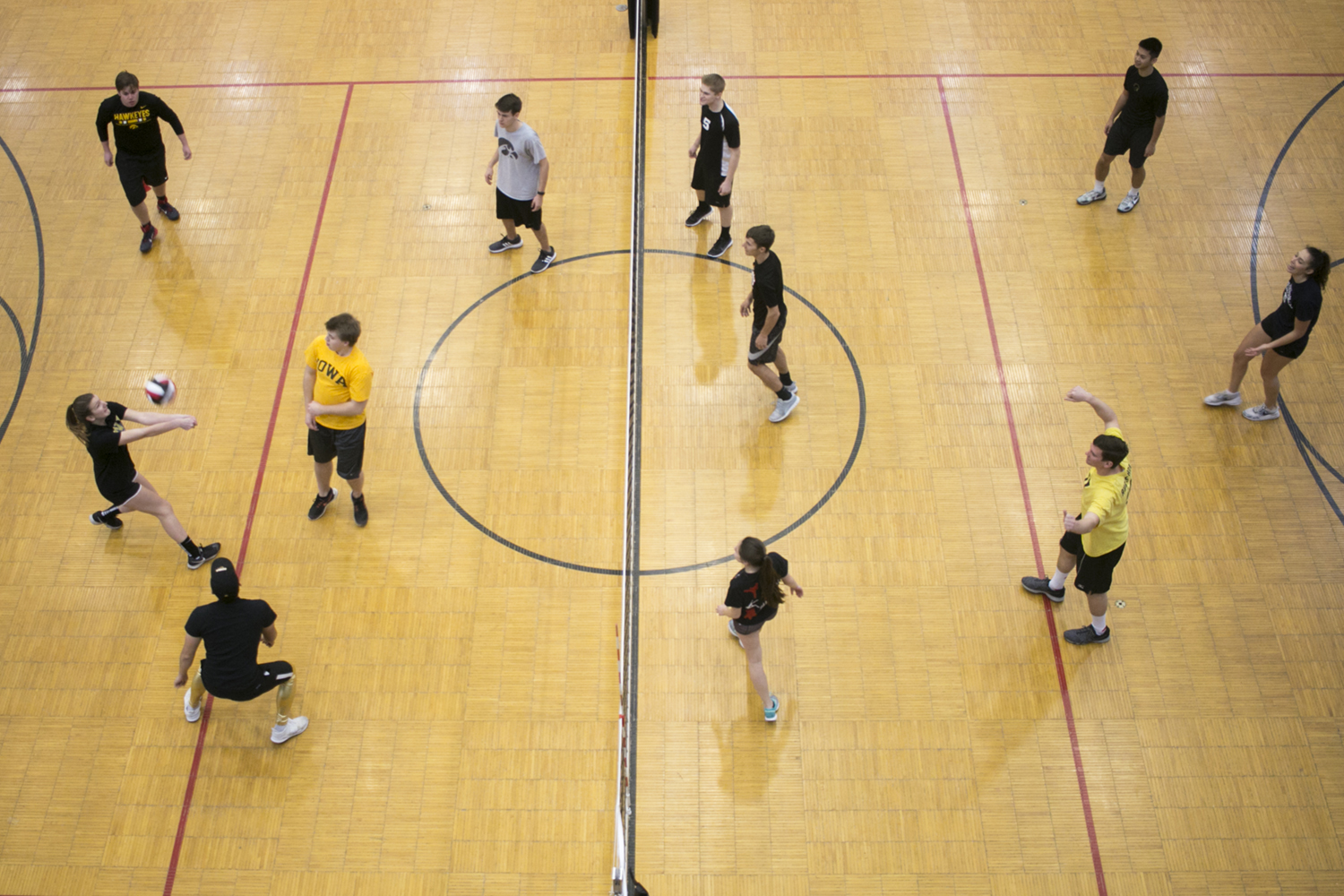 University of Iowa students play a charity game of volleyball in the Field House on Sunday, Dec. 3, 2017.