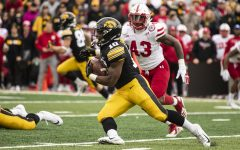 Iowa running back Mekhi Sargent carries the ball during Iowa's game against Nebraska at Kinnick Stadium in Iowa City on Friday, Nov. 23, 2018.