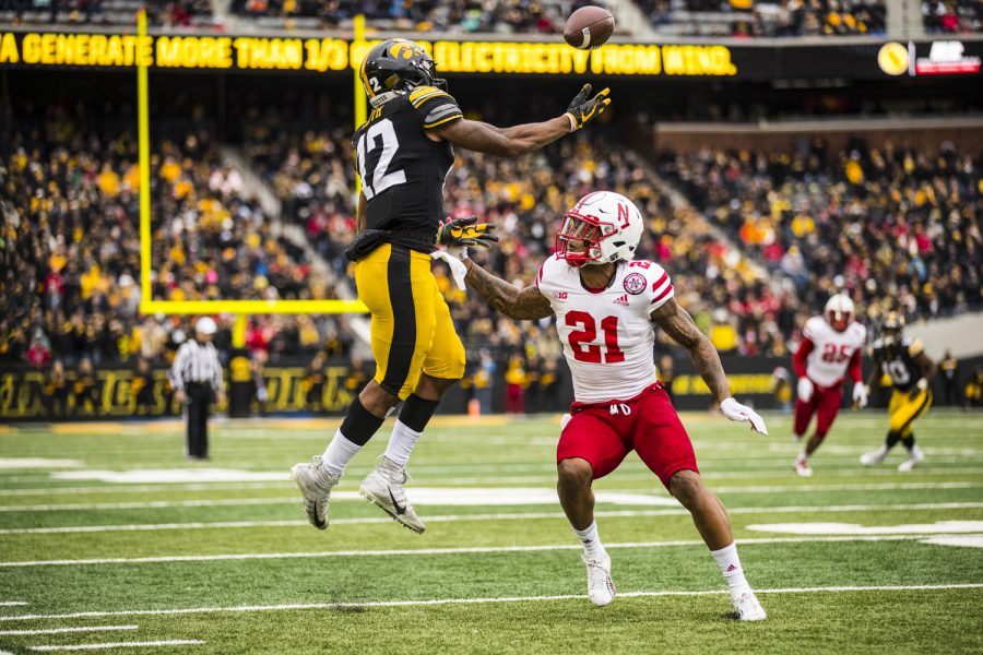Iowa wide receiver Brandon Smith makes a leaping catch during Iowa's game against Nebraska at Kinnick Stadium in Iowa City on Friday, November 23, 2018. The Hawkeyes defeated the Huskers 31-28.