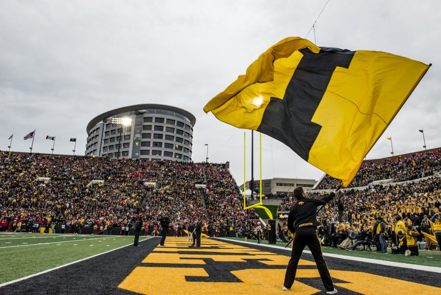A+Hawkeye+spirit+squad+member+waves+an+%22I%22+flag+after+a+touchdown+during+Iowa%27s+game+against+Nebraska+at+Kinnick+Stadium+in+Iowa+City+on+Friday%2C+November+23%2C+2018.+The+Hawkeyes+defeated+the+Huskers%2C+31-28.