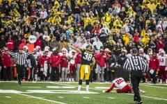 Iowa tight end T.J. Hockenson celebrates picking up a crucial first down during Iowa's game against Nebraska at Kinnick Stadium in Iowa City on Friday, November 23, 2018. The Hawkeyes defeated the Huskers 31-28.