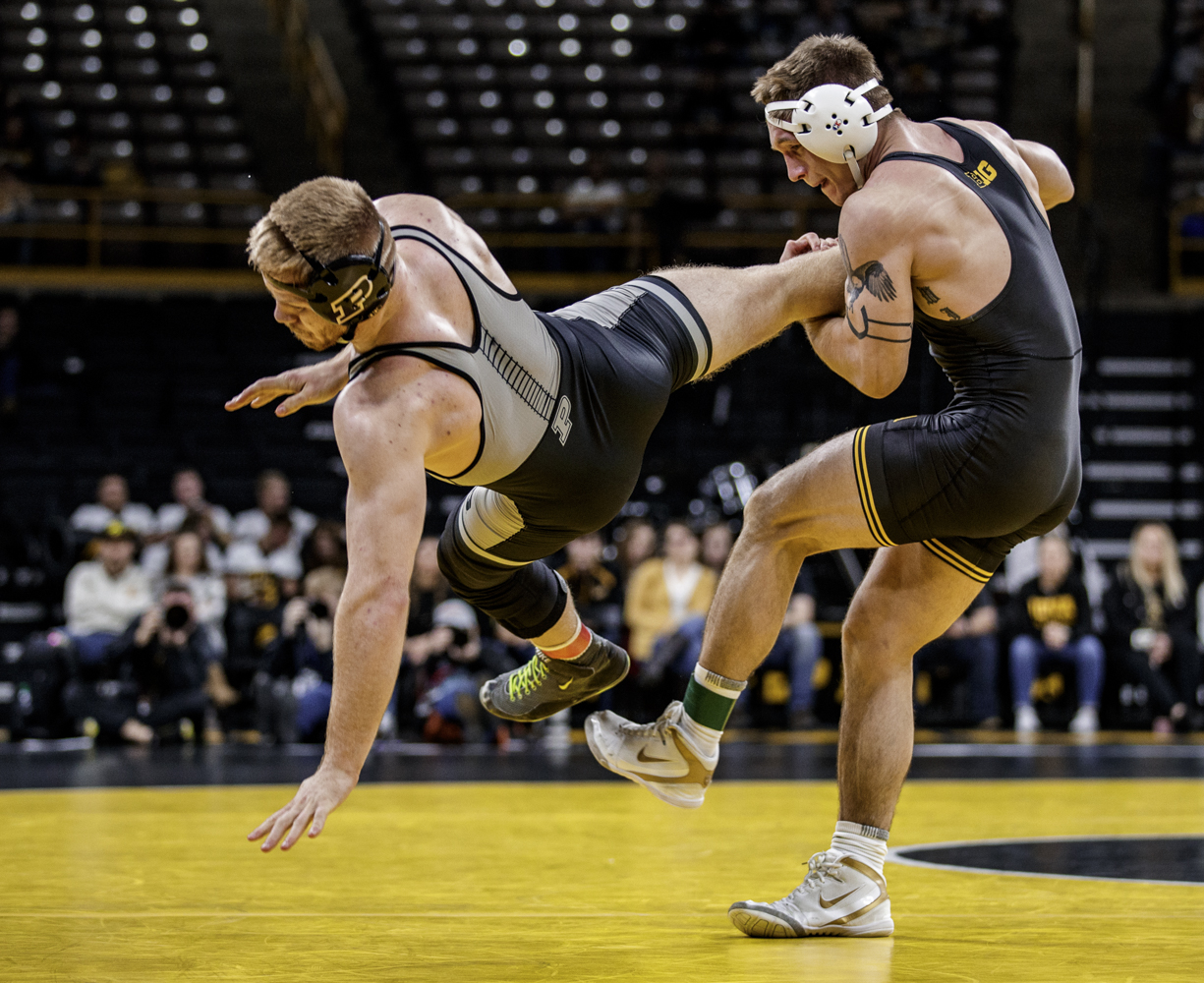 Iowa's Cash Wilcke takes down Purdue's Max Lyon during Iowa's dual meet against Purdue at Carver-Hawkeye Arena in Iowa City on Saturday, November 24, 2018. Wilcke defeated Lyon 12-4 in a major decision. The Hawkeyes defeated Boilermakers 26-9.