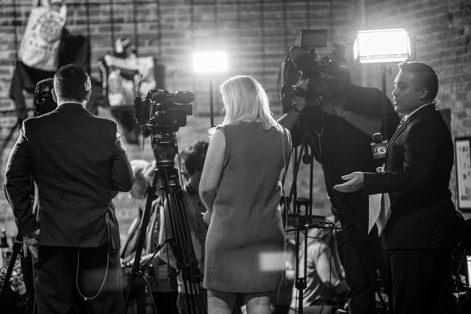 Televison reporters prepare to go live as polls close at 9 p.m. during a watch party for Democratic candidate for Iowa's first congressional district Abby Finkenauer at 7 Hills Brewing Company in Dubuque Iowa on Tuesday Nov. 6, 2018.