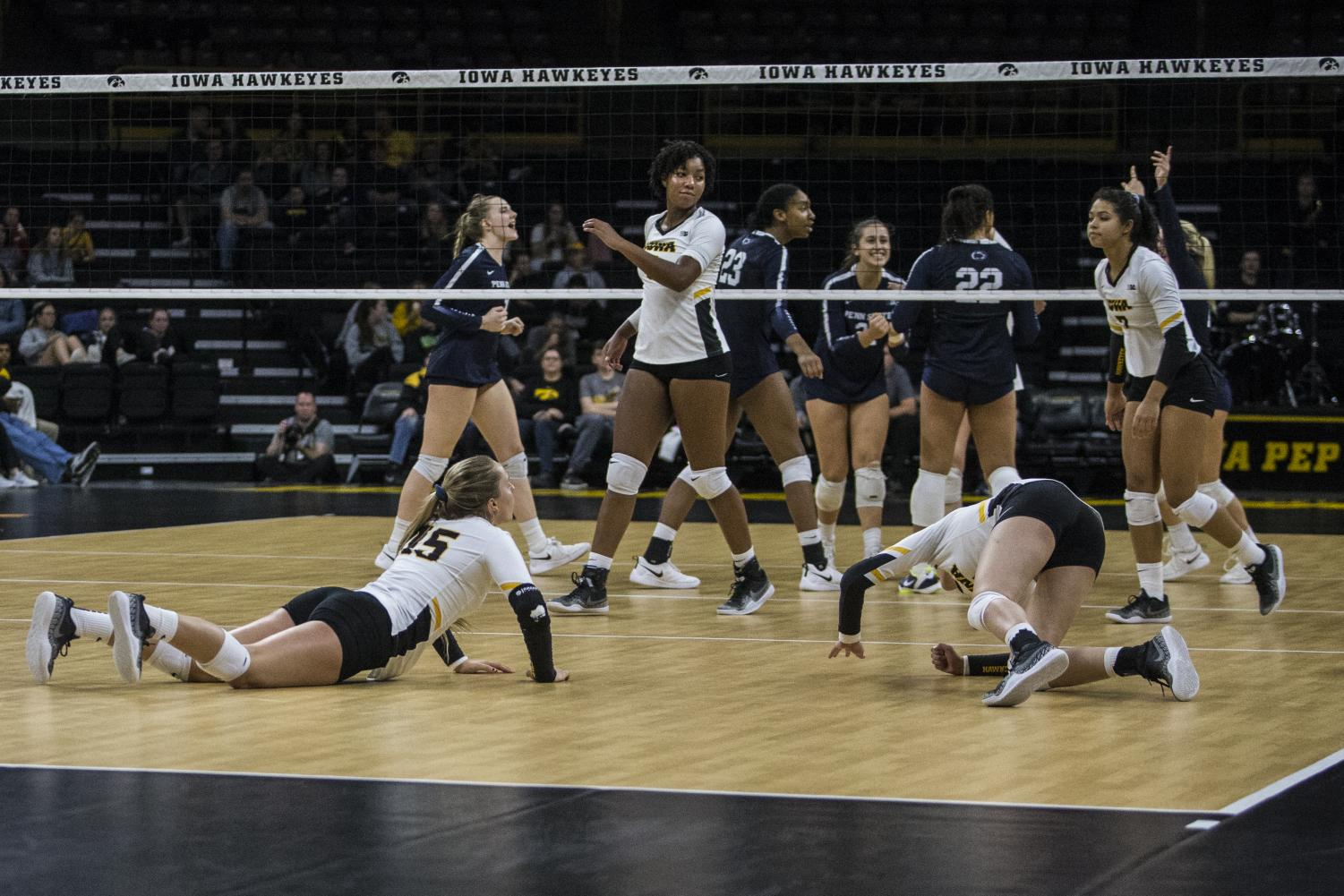 Iowa players dive for the ball during a volleyball match between Iowa and Penn State on Saturday, Nov. 3, 2018. The Hawkeyes were shut out by the Nittany Lions, 3-0.