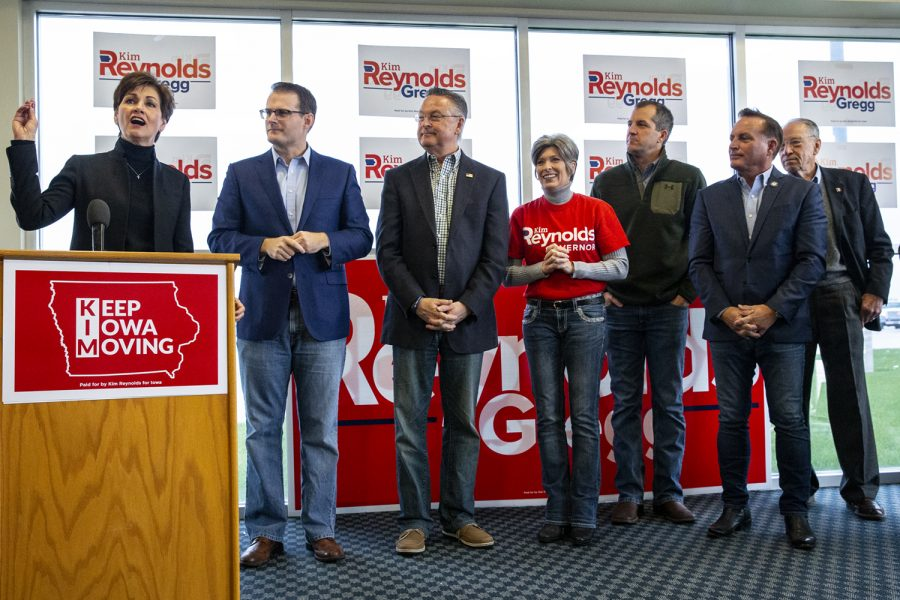 Governor+Kim+Reynolds+speaks+during+a+rally+at+the+Eastern+Iowa+Airport+in+Cedar+Capids+on+Monday%2C+Nov.+5%2C+2018+as+Lieutenant+Governor+Adam+Gregg%2C+Congressman+Rod+Blum%2C+R-Iowa%2C+Sen.+Joni+Ernst%2C+R-Iowa%2C+Iowa+Secretary+of+Agriculture+Mike+Naig%2C+Iowa+Secretary+of+State+Paul+Pate%2C+and+Senator+Chuck+Grasley%2C+R-Iowa%2C+look+on.+The+event+was+part+of+Reynolds%E2%80%99+flying+tour+of+Iowa+on+the+day+before+the+midterm+elections.+%28Nick+Rohlman%2FThe+Daily+Iowan%29
