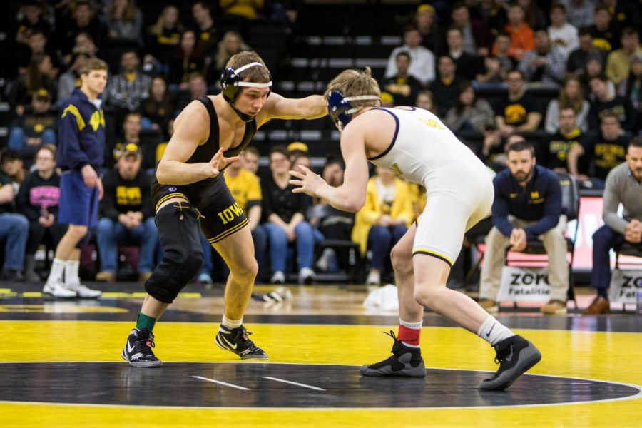 Iowa wrestler Spencer Lee grapples with Michigan wrestler Drew Martin at Carver-Hawkeye Arena on Saturday, Jan. 27, 2018. The Wolverines defeated the Hawkeyes 19-17.