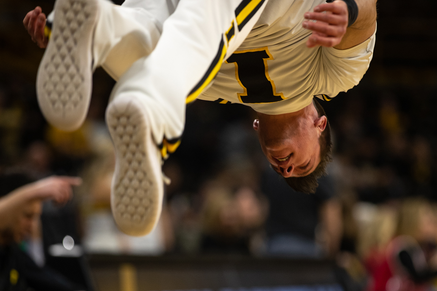 A+spirit+squad+individual+performs+a+flip+during+the+men%27s+basketball+game+against+Savannah+State+at+Carver-Hawkeye+Arena+on+Tuesday%2C+December+22%2C+2018.+The+Hawkeyes+defeated+the+Tigers+110-64.