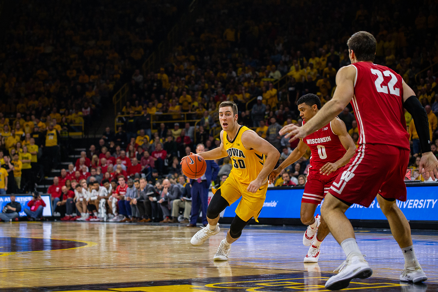 Iowa guard Connor McCaffery drives towards the basket during Iowa's game against Wisconsin at Carver-Hawkeye Arena on November 30, 2018. The Hawkeyes were defeated by the Badgers 72-66.