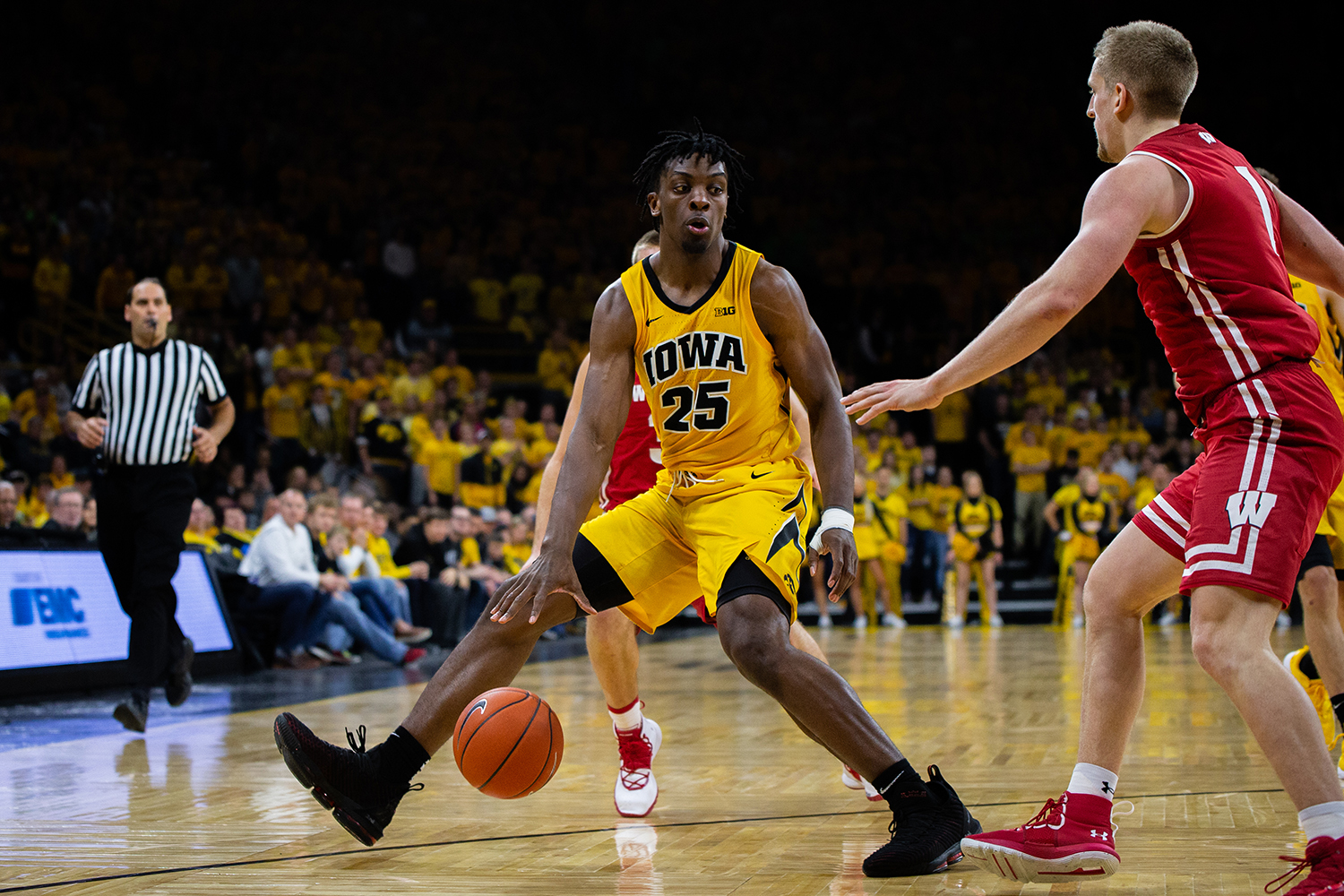 Iowa forward Tyler Cook dribbles down the baseline during Iowa's game against Wisconsin at Carver-Hawkeye Arena on November 30, 2018. The Hawkeyes were defeated by the Badgers 72-66.