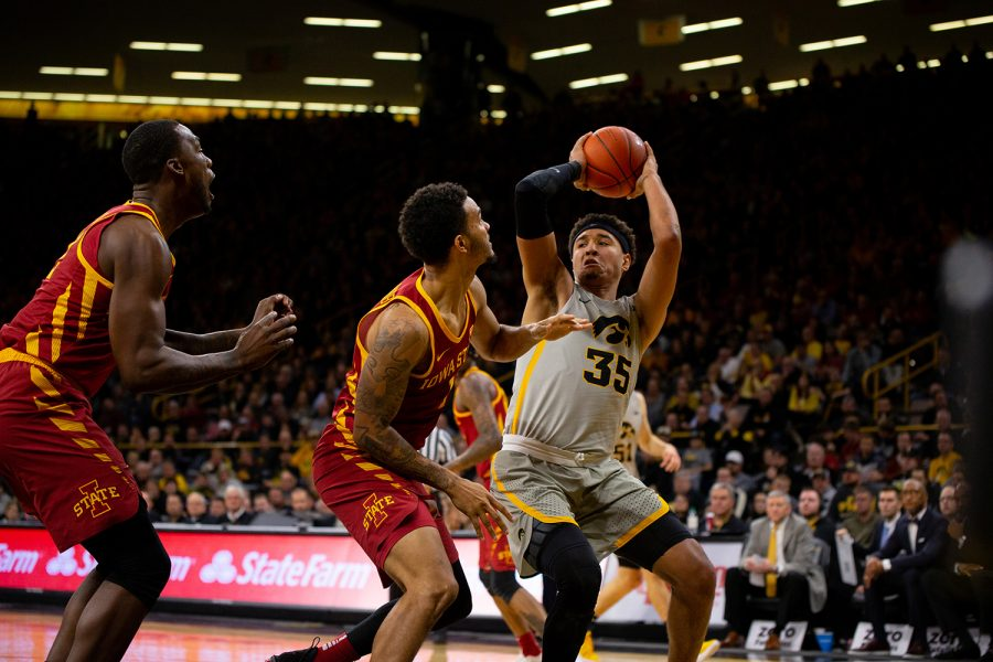 Iowa+forward+Cordell+Pemsl+looks+to+pass+during+Iowa%27s+game+against+Iowa+State+at+Carver-Hawkeye+Arena+on+December+6%2C+2018.+The+Hawkeyes+defeated+the+Cyclones+98-84.