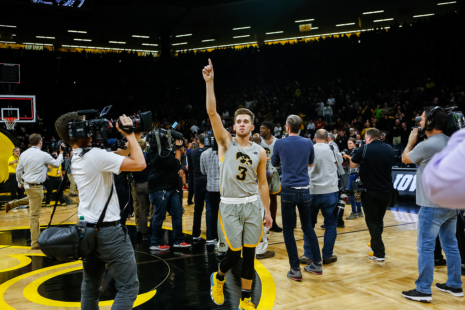 Iowa guard Jordan Bohannon celebrates after Iowa's game against Iowa State at Carver-Hawkeye Arena on December 6, 2018. The Hawkeyes defeated the Cyclones 98-84.