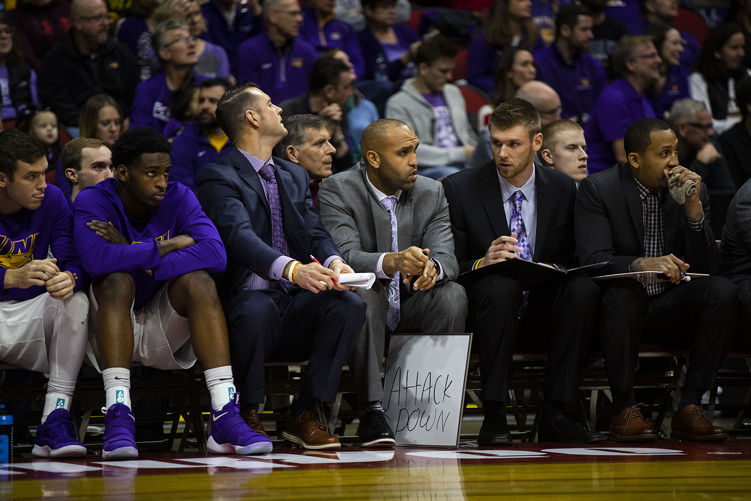 UNI+coaches+hold+a+white+board+during+the+Iowa%2FUNI+men%27s+basketball+game+at+Wells+Fargo+Arena+in+Des+Moines+on+Saturday%2C+Dec.+15%2C+2018.+The+Hawkeyes+defeated+the+Panthers%2C+77-54.+