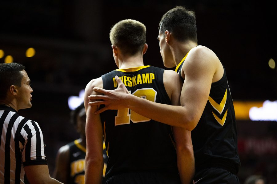 Iowa's Luka Garza pats Joe Wieskamp on the back during the Iowa/UNI men's basketball game at Wells Fargo Arena in Des Moines on Saturday, Dec. 15, 2018. The Hawkeyes defeated the Panthers, 77-54.