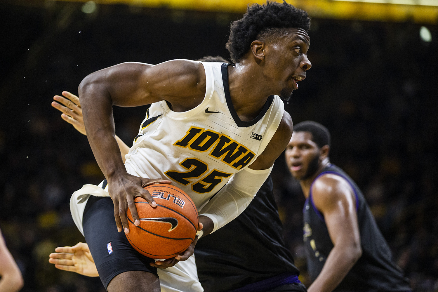 Iowa forward Tyler Cook (25) dribbles the ball during the men's basketball game against Western Carolina at Carver-Hawkeye Arena on Tuesday, December 18, 2018. The Hawkeyes defeated the Catamounts 78-60.