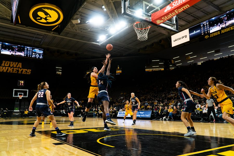Center+Megan+Gustafson+shoots+the+ball+during+the+womans+basketball+game+at+Carver+Hawkeye+Arena+on+December+2%2C+2018.+The+Hawkeyes+won+against+Robert+Morris+92-63.+%28Roman+Slabach%2FThe+Daily+Iowan%29