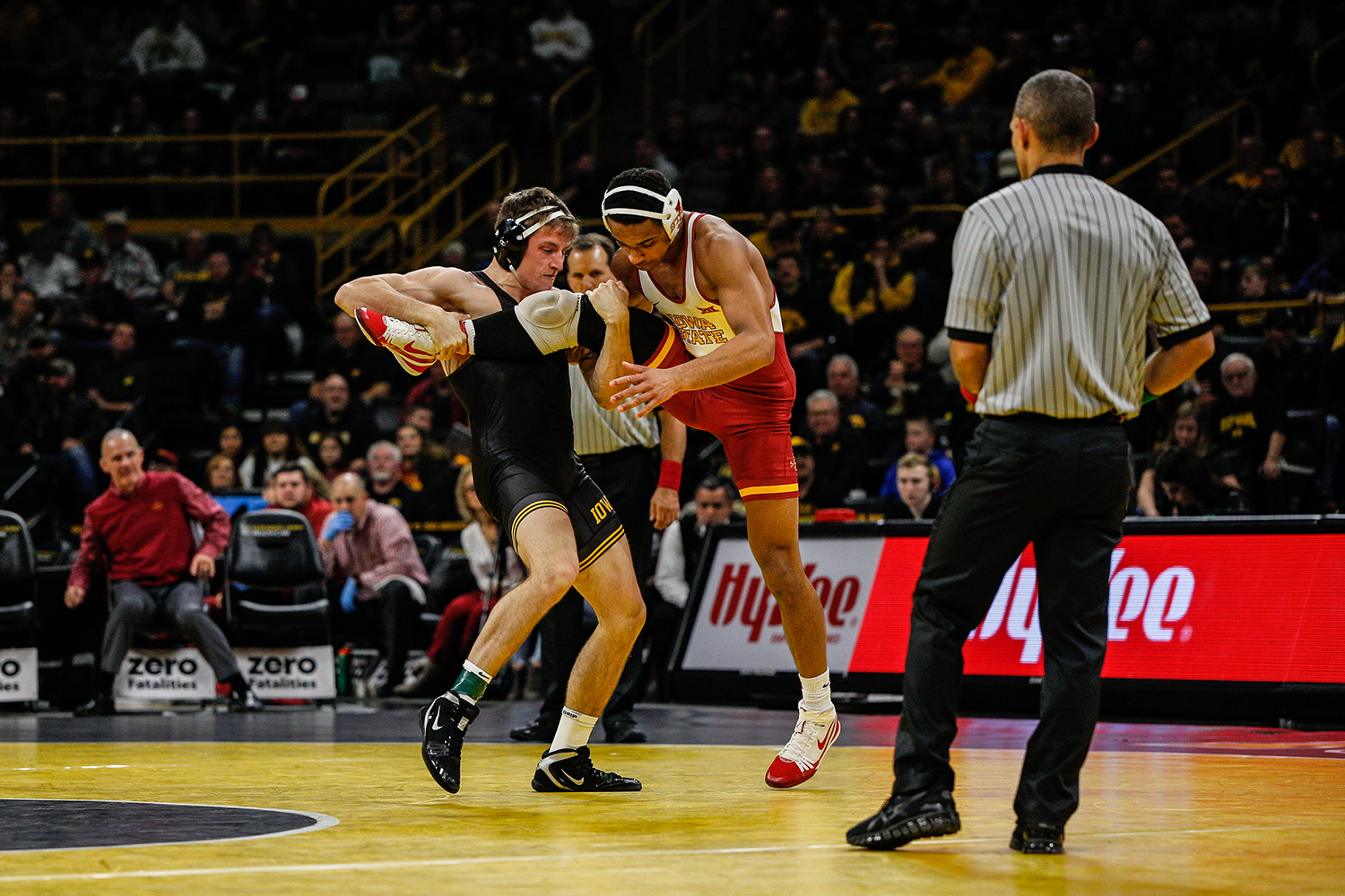Iowa's Myles Wilson wrestles Iowa State's Marcus Coleman during Iowa's dual meet against Iowa State at Carver-Hawkeye Arena in Iowa City on Saturday, December 1, 2018. Wilson lost to Coleman after an injury default. Iowa defeated the Cyclones 19-18. (Wyatt Dlouhy/The Daily Iowan)
