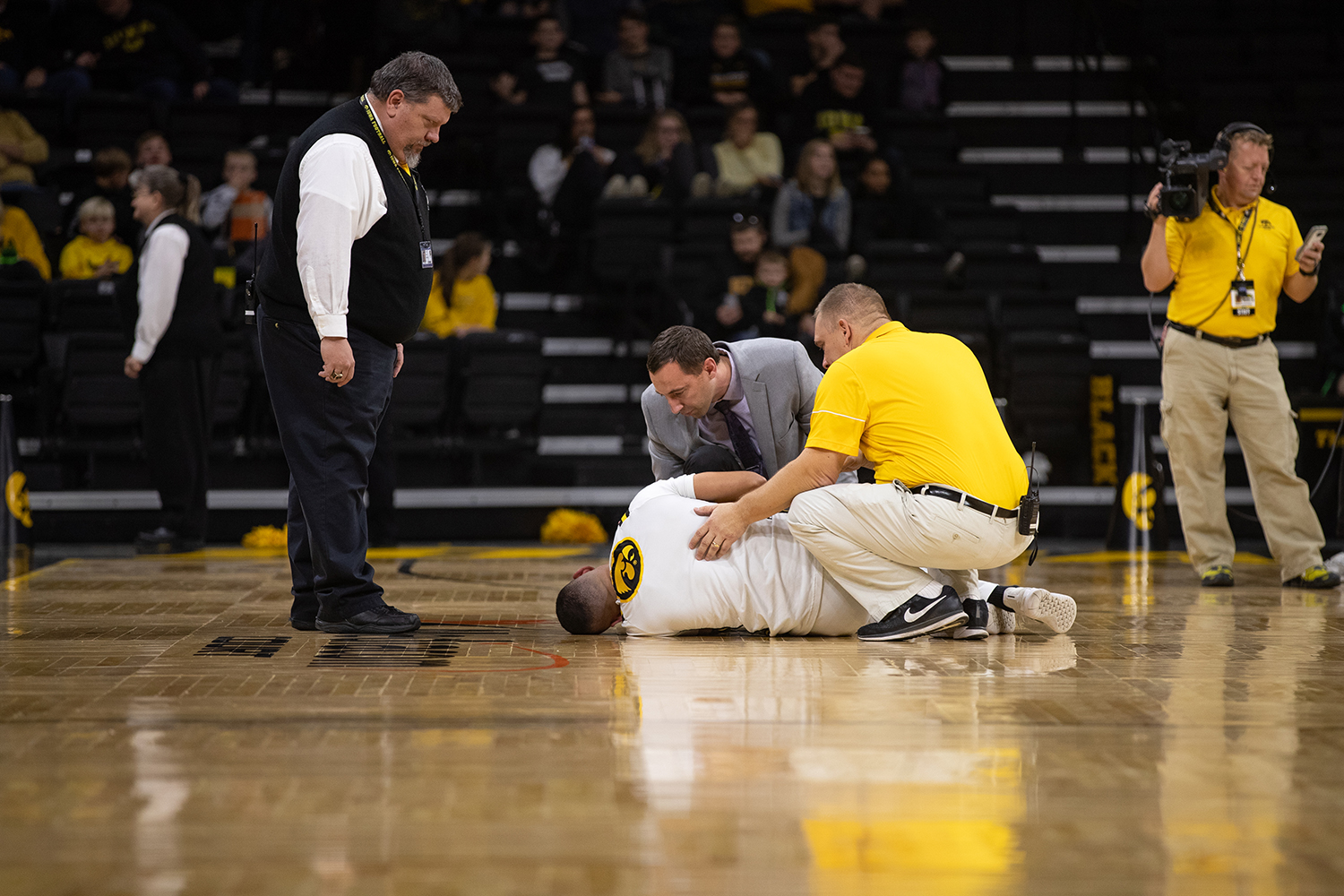 A+spirit+squad+member+lays+on+the+ground+after+injuring+his+shoulder+during+the+men%27s+basketball+game+against+Savannah+State+at+Carver-Hawkeye+Arena+on+Tuesday%2C+December+22%2C+2018.+The+Hawkeyes+defeated+the+Tigers+110-64.