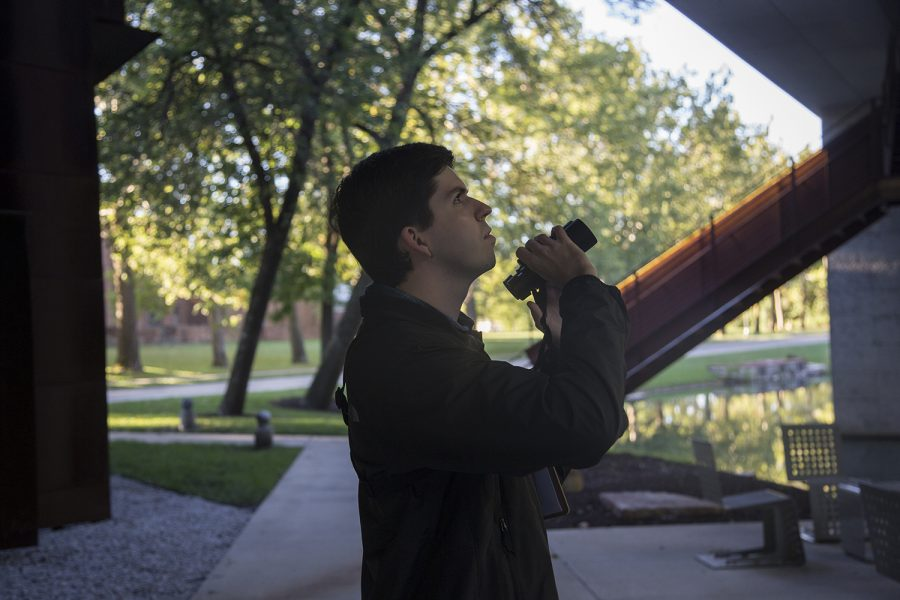 University of Iowa student Elliot Stalter walks around Art Building West in Iowa City on Saturday, Sept. 22, 2018. Stalter conducted research on how building construction, lights, and windows affect deadly bird collisions.
