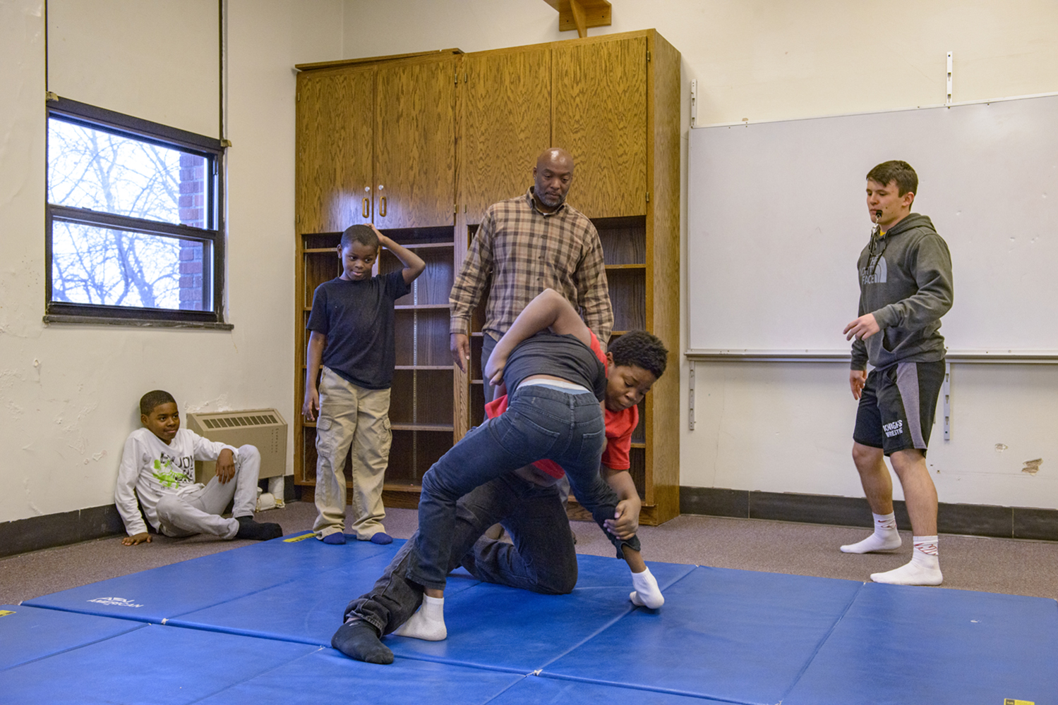 Fifth Ward Saints founder Carlos Honore works with students and volunteer coaches during a wrestling practice at Theodore Roosevelt Education Center on Monday, December 10, 2018. Fifth Ward Saints provides social-services alongside a variety of athletic and activity based after school programs to at risk students.