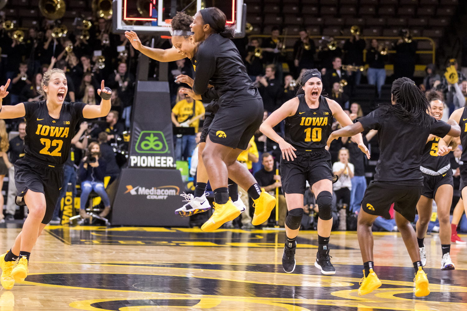Iowa forward Megan Gustafson #10 and her teammates celebrate after defeating Iowa State in a women's basketball game at Carver-Hawkeye Arena on Wednesday, Dec. 5, 2018. The Hawkeyes defeated the Cyclones 73-70.