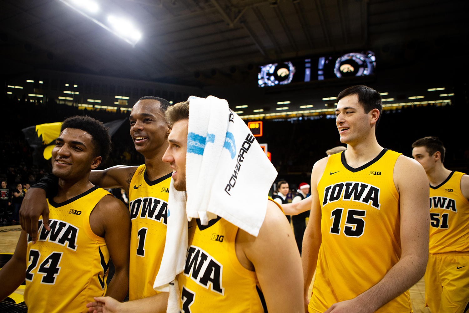 The+players+celebrate+post+victory+during+the+men%27s+basketball+game+against+Savannah+State+at+Carver-Hawkeye+Arena+on+Tuesday%2C+December+22%2C+2018.+The+Hawkeyes+defeated+the+Tigers+110-64.