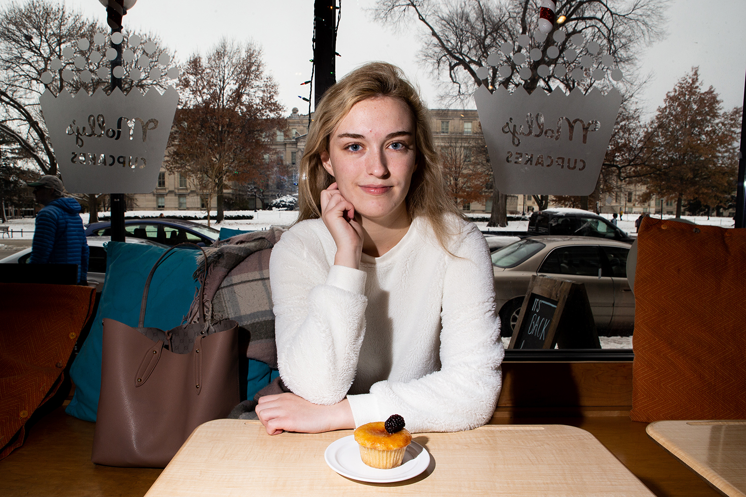 Danielle Leveille poses for a portrait in Molly's Cupcakes in Iowa City on Wednesday, Nov. 28, 2018.