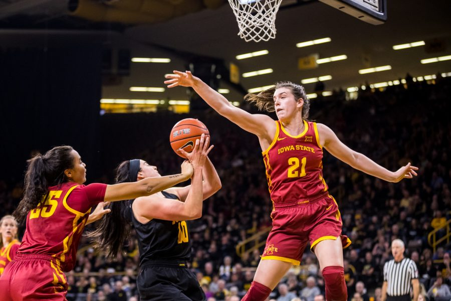 Iowa+State+guard+Bridget+Carleton+%2321+tries+to+block+the+shot+of+Iowa+forward+Megan+Gustafson+%2310+during+a+women%27s+basketball+game+against+The+University+of+Iowa+at+Carver-Hawkeye+Arena+on+Wednesday%2C+Dec.+5%2C+2018.+The+Hawkeyes+defeated+the+Cyclones+73-70.+