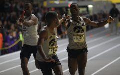 Antonio Woodward and Raymonte Dow make an exchange in the 4x400 meter relay during the Larry Wieczorek Invitational meet in Iowa City, Iowa; Saturday January 20, 2018.