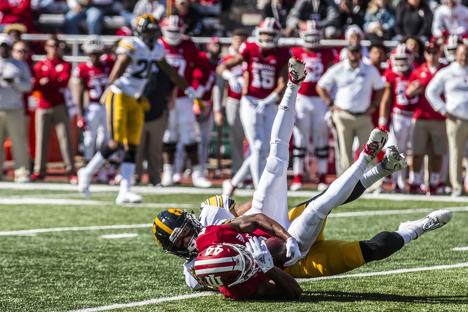 Iowa defensive back Amani Hooker tackles Indiana wide receiver J-Shun Harris during Iowa's game at Indiana at Memorial Stadium in Bloomington on Saturday, October 13, 2018. The Hawkeyes beat the Hoosiers 42-16.