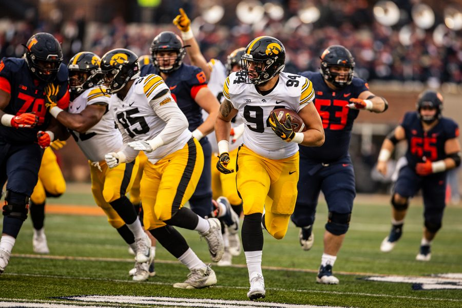 Iowa+defensive+lineman+A.J.+Epenesa+returns+a+fumble+for+a+touchdown+during+Iowa%27s+game+against+Illinois+at+Memorial+Stadium+in+Champaign+on+Saturday%2C+Nov.+17%2C+2018.+The+Hawkeyes+defeated+the+Fighting+Illini+63-0.