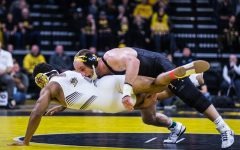 Iowa's Alex Marinelli wrestles Lehigh's Cole Walter during a wrestling dual-meet between Iowa and Lehigh at Carver-Hawkeye Arena on Saturday, Dec. 8, 2018. Marinelli, who is ranked fourth at 165, defeated Walter 20-5, and the Hawkeyes defeated the Mountain Hawks, 28-14.