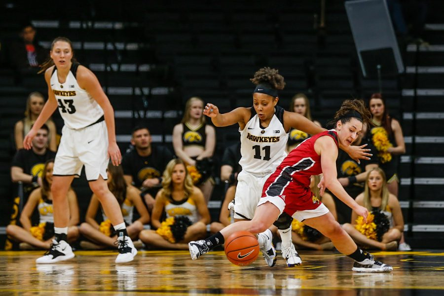 Iowa guard Tania Davis runs for the ball at the women's basketball game against IUPUI at Carver-Hawkeye Arena on Saturday, December 8, 2018. The Hawkeyes defeated the Jaguars 72-58.