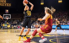 Iowa guard Kathleen Doyle #22 looks to shoot after driving back Iowa State guard Ashley Joens #24 during a women's basketball game against Iowa State University at Carver-Hawkeye Arena on Wednesday, Dec. 5, 2018. The Hawkeyes defeated the Cyclones 73-70.