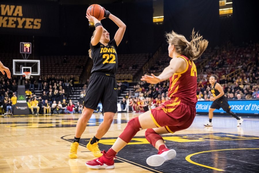 Iowa+guard+Kathleen+Doyle+%2322+looks+to+shoot+after+driving+back+Iowa+State+guard+Ashley+Joens+%2324+during+a+women%27s+basketball+game+against+Iowa+State+University+at+Carver-Hawkeye+Arena+on+Wednesday%2C+Dec.+5%2C+2018.+The+Hawkeyes+defeated+the+Cyclones+73-70.+