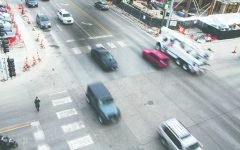 Cars drive on Burlington Street in Iowa City on Tuesday, Dec. 11, 2018.