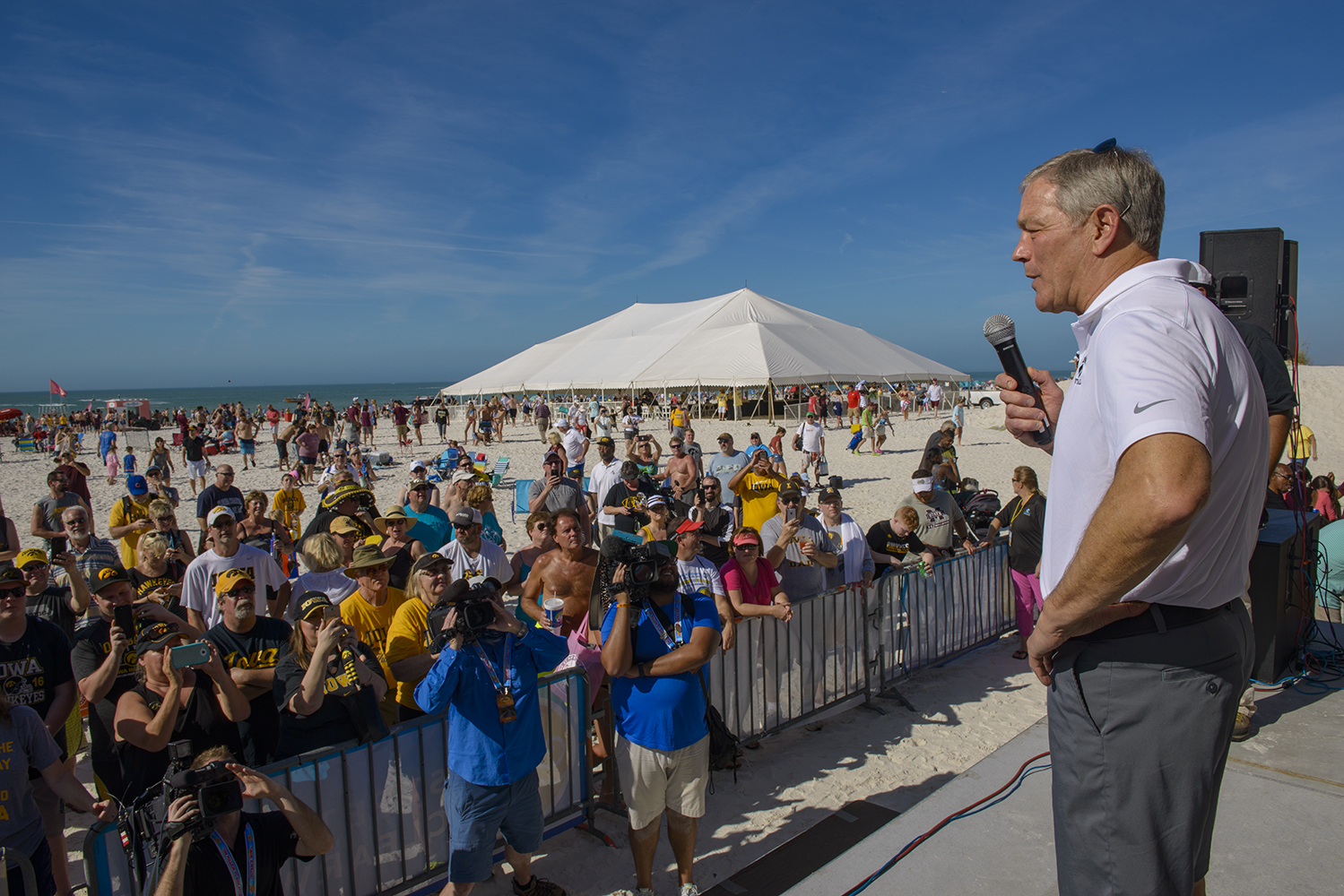 Iowa head coach Kirk Ferentz addresses fans during  Outback Bowl Beach Day at the Hilton Clearwater Beach Resort in Clearwater, Florida on Sunday Dec. 30, 2018. The day's festivities included a variety of events for fans and general merrymaking.