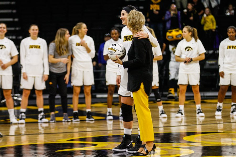 Head+coach+Lisa+Bluder+presents+Iowa+center+Megan+Gustafson+with+an+award+recognizing+her+for+a+record-high+number+of+rebounds+throughout+the+season+before+the+women%27s+basketball+game+against+IUPUI+at+Carver-Hawkeye+Arena+on+Saturday%2C+December+8%2C+2018.+The+Hawkeyes+defeated+the+Jaguars+72-58.+