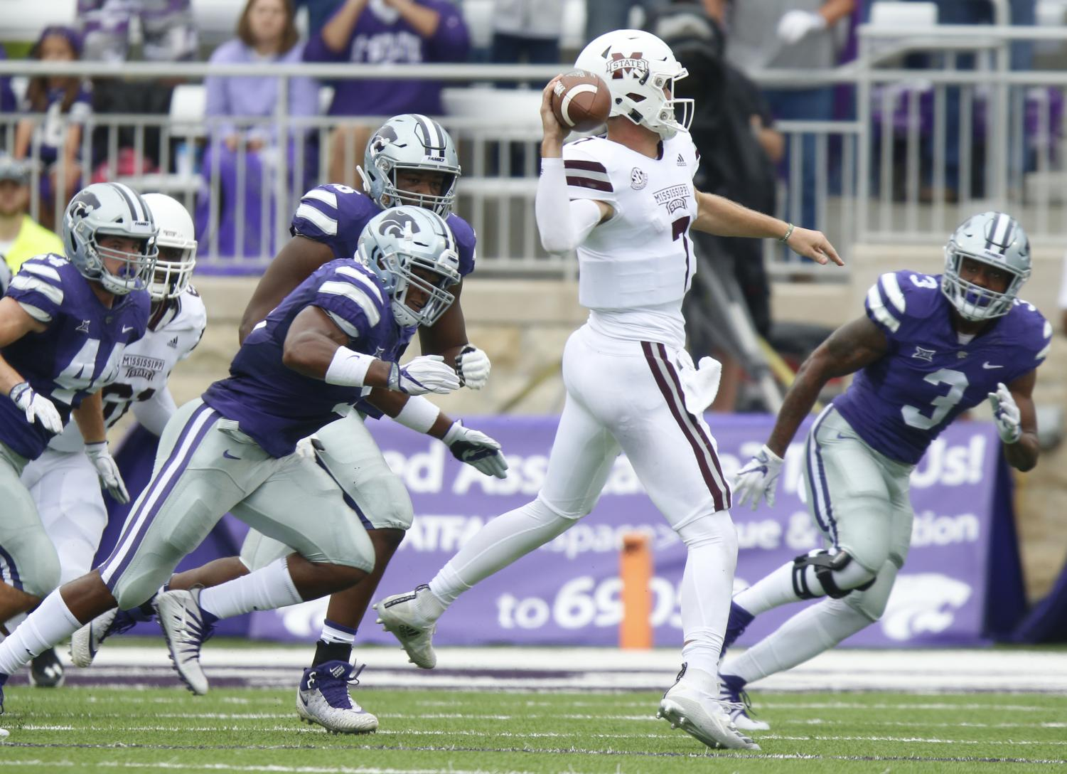Kansas State defenders try to contain Mississippi State quarterback Nick Fitzgerald (7) in the first half on Saturday, Sept. 8, 2018, at Snyder Family Stadium in Manhattan, Kan. Mississippi State won, 31-10. (Bo Rader/Wichita Eagle/TNS)