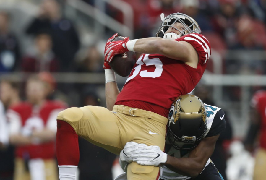 San Francisco 49ers George Kittle (85) makes a catch against Jacksonville Jaguars Barry Church (42) in the first quarter at Levis Stadium Sunday, Dec. 24, 2017 in Santa Clara, California. (Nhat V. Meyer/Bay Area News Group/TNS)