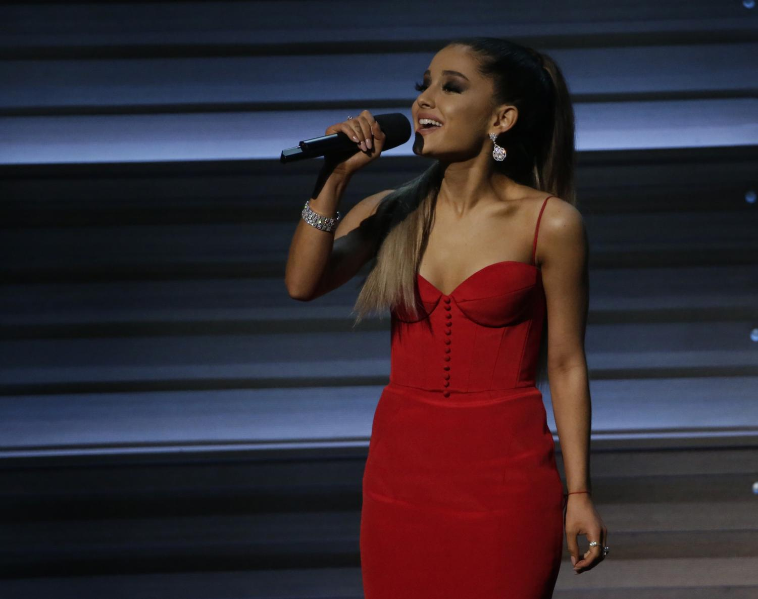 Ariana Grande introduces The Weekend at the 58th Annual Grammy Awards on Feb. 15, 2016 in Los Angeles. Grande is holding a benefit concert in Manchester after this week's attack. (Robert Gauthier / Los Angeles Times)