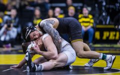 Iowa's Pat Lugo wrestles Lehigh's Jimmy Hoffman during a wrestling dual-meet between Iowa and Lehigh at Carver-Hawkeye Arena on Saturday, Dec. 8, 2018. Lugo, who is ranked tenth at 149, defeated Hoffman 12-3, as the Hawkeyes defeated the Mountain Hawks, 28-14.