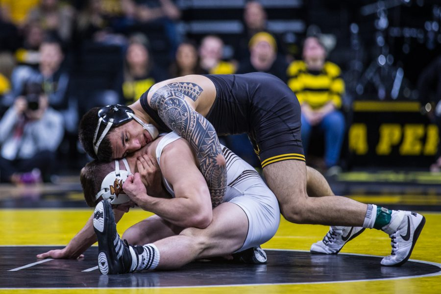 Iowa%27s+Pat+Lugo+wrestles+Lehigh%27s+Jimmy+Hoffman+during+a+wrestling+dual-meet+between+Iowa+and+Lehigh+at+Carver-Hawkeye+Arena+on+Saturday%2C+Dec.+8%2C+2018.+Lugo%2C+who+is+ranked+tenth+at+149%2C+defeated+Hoffman+12-3%2C+as+the+Hawkeyes+defeated+the+Mountain+Hawks%2C+28-14.+