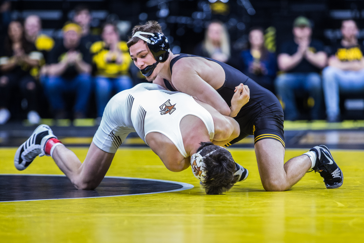 Iowa's Spencer Lee wrestles Lehigh's Luke Resnick during a wrestling dual-meet between Iowa and Lehigh at Carver-Hawkeye Arena on Saturday, Dec. 8, 2018. Lee, who is top ranked at 125, defeated Resnick 15-0, and the Hawkeyes defeated the Mountain Hawks, 28-14.