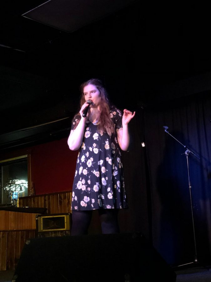 UI+student+Brigid+Martin+performs+a+five+minute+stand-up+bit+as+a+part+of+her+Stand-up+Comedy+Practicum+class.+The+show+was+hosted+in+The+Mill+on+Sunday%2C+Dec.+9.