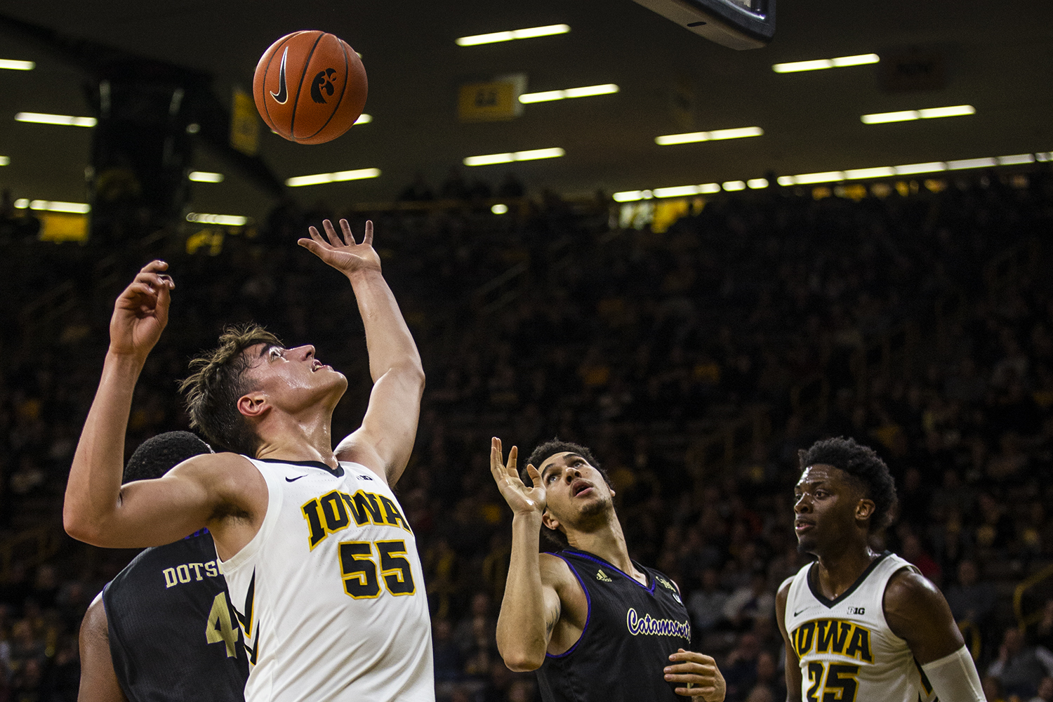 Iowa forward Luka Garza jumps for a rebound during the men's basketball game against Western Carolina at Carver-Hawkeye Arena on Tuesday, December 18, 2018. The Hawkeyes defeated the Catamounts 78-60.