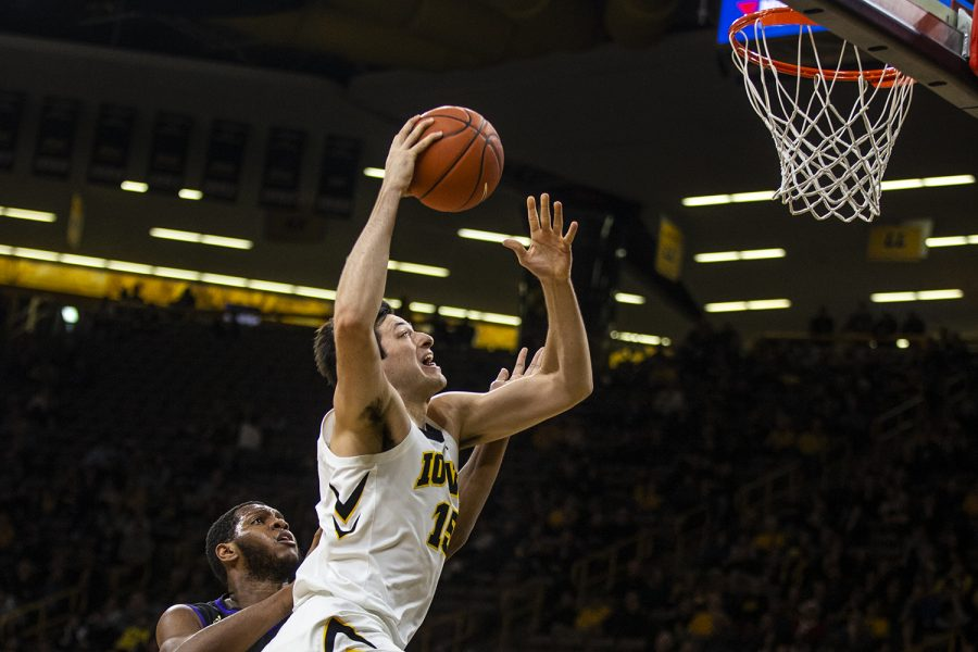 Iowa+forward+Ryan+Kriener+%2815%29+attempts+to+make+a+dunk+during+the+men%27s+basketball+game+against+Western+Carolina+at+Carver-Hawkeye+Arena+on+Tuesday%2C+December+18%2C+2018.+The+Hawkeyes+defeated+the+Catamounts+78-60.+