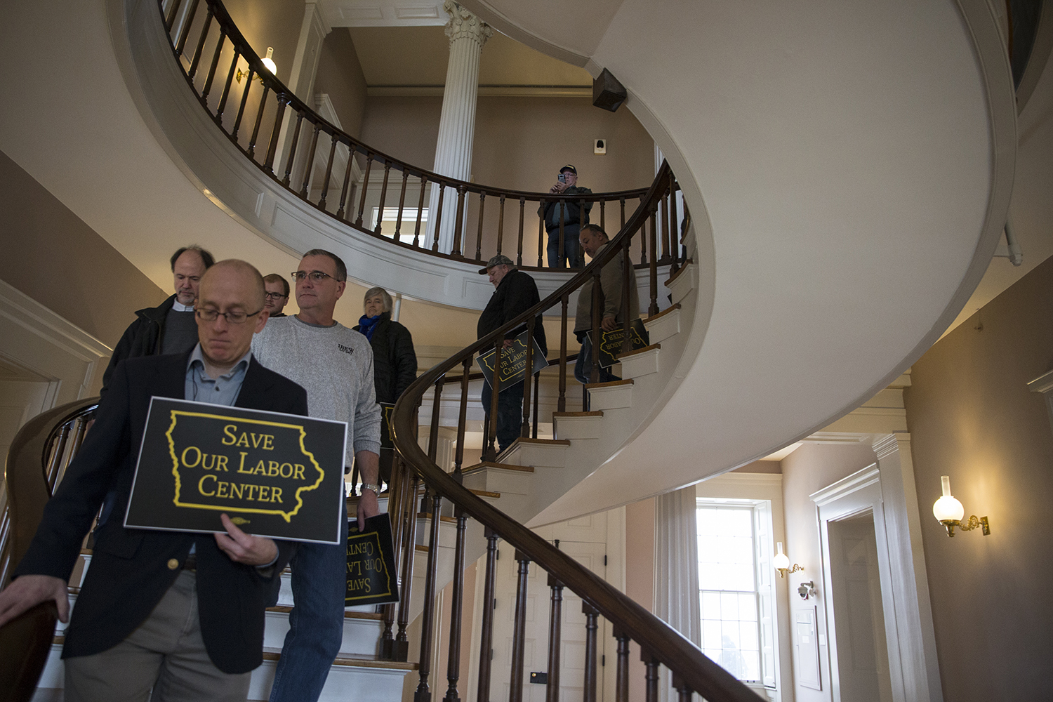 Crowd members move out of the meeting room to walk to President Bruce Harreld's office during the Labor Center Statewide Summit in the Old Capitol Senate Chambers on Monday Dec. 3, 2018. Members of the university and the community addressed concerns over the Labor Center closure before taking their petition to Harreld's office.