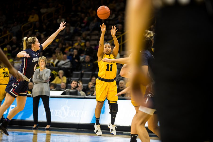 Guard+Tania+Davis+attempts+a+three-pointer+during+the+women%27s+basketball+game+at+Carver+Hawkeye+Arena+on+Dec.+2%2C+2018.+The+Hawkeyes+won+against+Robert+Morris+92-63.+