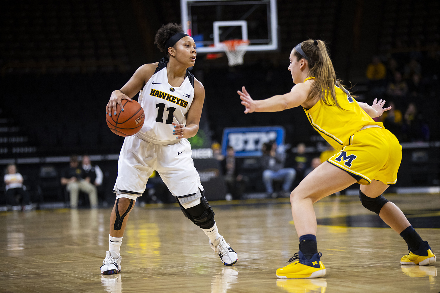 Iowa+guard+Tania+Davis+attempts+to+pass+the+ball+during+the+Iowa%2FMichigan+women%27s+basketball+game+at+Carver-Hawkeye+Arena+on+Thursday%2C+January+17%2C+2019.++The+Hawkeyes+defeated+the+Wolverines%2C+75-61.+