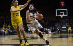 Iowa women prevail down low against Michigan
